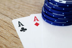 Poker game with aces and blue chips Stock Photography