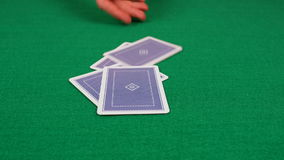 Poker Game Cards dealt to Player by Dealer on Felt Table 4K UHD Royalty Free Stock Photography