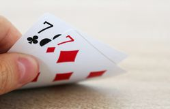 Poker game with hand of two lucky sevens. Photo of poker game with hand of two lucky sevens Royalty Free Stock Image