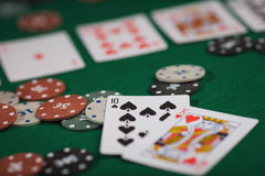 Poker game in men`s hands on green table.  Royalty Free Stock Photography