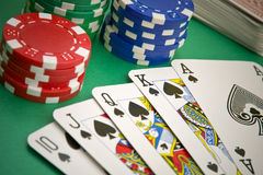 Poker game royal flush. Chips and deck of cards royalty free stock images