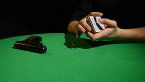 Poker game - shuffling cards. Man`s hands shuffing cards. Close up.  royalty free stock images