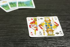 Poker game - there are two kings in the exposed playing cards. Stock Image
