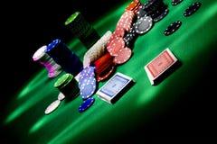 Poker gear light impression. Casino gambling chips on green table Stock Photo