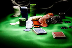 Poker gear light impression. Casino gambling chips on green table Stock Photos