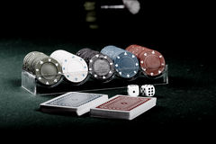 Poker gear vintage. Casino gambling chips on green table Royalty Free Stock Photos