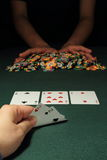 Poker Hand. Image of poker hand showing two players. The first player with four of a kind, while the other player pushing all poker chips in stock image