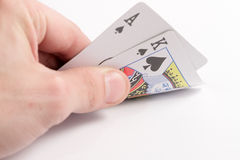 Poker hand. Poker winning hand with Ace and King possible flush or straight, good hand suited spades stock photos