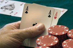 Poker Hand. And the money kept rolling in Stock Photos