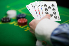 Poker hand. Flush of spades in hand at a game of poker Royalty Free Stock Photo