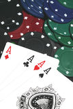 Poker hand. Photograph of a poker hand with chips stock image