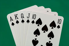 Poker hand. Royal flush of spades - (isolated with a clipping path Stock Images