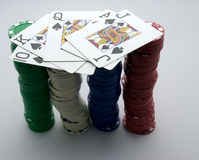 Poker hand and chips (2). A background of scattered poker chips and cards Royalty Free Stock Images