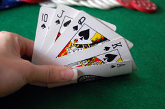 Poker Hand with Chips. Texas Hold'em Poker with chips in background Stock Photo