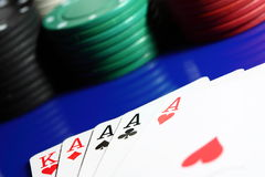 Poker hand with chips A. Photograph of a poker hand with stacked chips Royalty Free Stock Photos