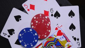 Poker Hand and Chips. Playing cards and chips of a poker hand stock video footage