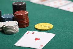 Poker hand with chips on a poker table. Two aces on big blind Royalty Free Stock Photography