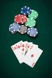 Poker hand Flush. Poker hand of five cards of Flush on a green table next to chips Stock Image