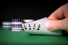 A poker hand of four aces. With chips and copy space background stock photography
