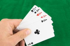 Poker Hand. Four aces infront of a green backgound stock photo