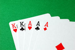 Poker Hand - Full House. A Full House - a high scoring poker hand laid out on green baize stock photo