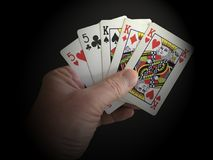 Poker hand with full house cards close up on black backgrund. Poker hand showing full house cards with kings in close up on black backgrund royalty free stock photography