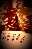 Poker hand with full house cards and jeton chips in close up on black backgrund - made like an old photo. Graph stock photography