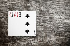 Poker hand: full house. playing cards game abstract in wooden table. With copyspace royalty free stock images