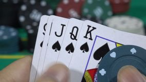Poker Hand and Game on Table at risk stock footage
