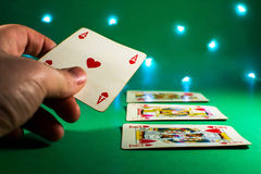 Poker hand with green table Royalty Free Stock Photography