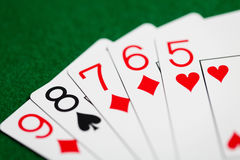 Poker hand of playing cards on green casino cloth Royalty Free Stock Photography