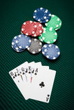 Poker hand Royal Flush. Poker hand of five cards of Royal Flush on a green table next to chips Stock Photos