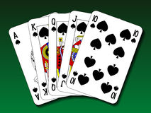 Poker hand - Royal flush spade. On green deck Royalty Free Stock Photo