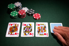 Poker hand royal flush win. Close up of cards with chips on green baize royalty free stock photo