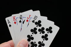 Poker hand with straight. Poker hand with ace high straight on a black background royalty free stock images