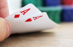 Poker hand with two aces and chips. Photo of poker hand with two aces and chips stock photos
