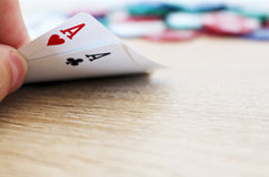 Poker hand with two aces and chips. Photo of poker hand with two aces and chips royalty free stock photography
