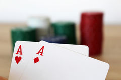 Poker hand with two aces before stack. Photo of poker hand with two aces before stack stock images