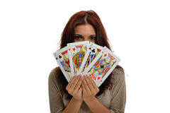 Poker in Hands. Beautiful brunette with Jacks Poker in hands stock image
