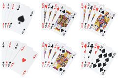 Poker hands. 7 poker hands isolated on white [with clipping path Royalty Free Stock Photo