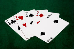 Poker hands - Four of a kind - seven and two Stock Image
