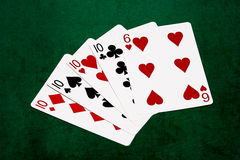 Poker hands - Four of a kind - ten and six Stock Image