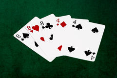 Poker hands - Full house - eight and four Stock Photo