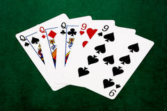 Poker hands - Full house - queens and nine Stock Photos
