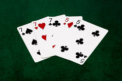 Poker hands - Full house - seven and five Royalty Free Stock Images
