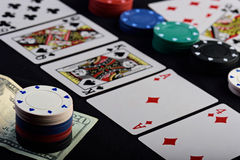 Poker holdem game. On black table with stake Royalty Free Stock Images
