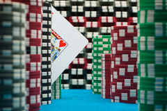 Poker king. Poker theme with cards and chips on blue ground Royalty Free Stock Image