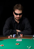 Poker man. Man in black shirt plaing poker in the casino Stock Images