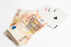 Poker and money. Four aces and European banknotes Royalty Free Stock Photo