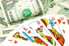 Poker Money. Poker Game with Royal Flush lying on Pot with dollars Royalty Free Stock Image